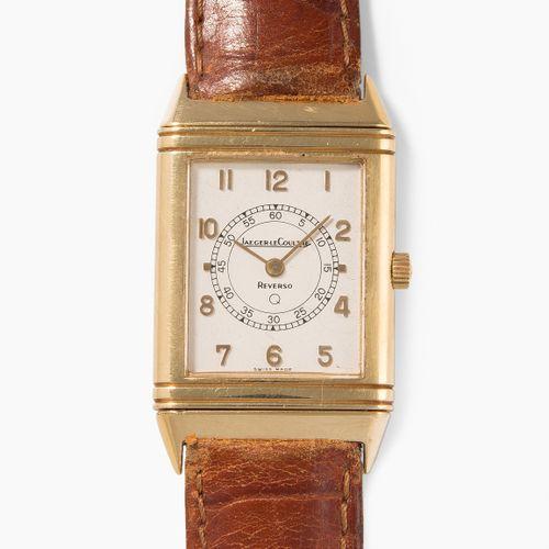 "JAEGER LECOULTRE 积家 ""Reverso Classique ""腕表  黄金表壳,39x23毫米。石英机芯。镀银表盘上有阿拉伯数字。真皮表带,镀…"