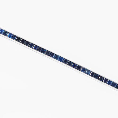SAPHIR BRACELET 蓝宝石手镯  Baltensperger.750黄金。47颗蓝宝石,每颗约3毫米,槽形镶嵌。17.5厘米,22.3克。