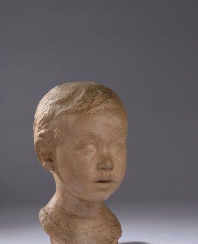 Marcel DAMBOISE (1903 1992)  TETE D'ALAIN ENFANT, 1930  Terre cuite  Signé et…