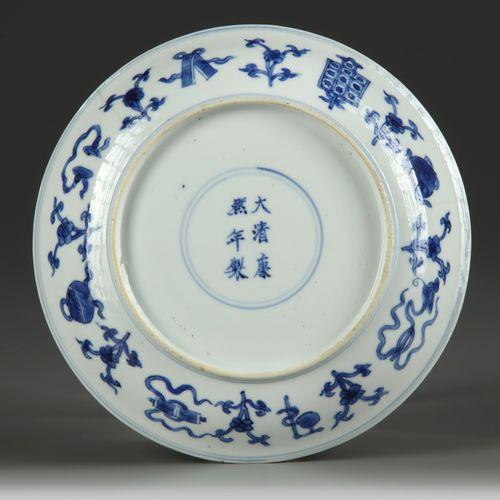 A CHINESE BLUE AND WHITE 'HUNDRED' TREASURES DISH, KANGXI (1662 1722) The dish i…