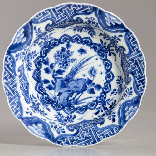 A CHINESE BLUE AND WHITE PHEASANT SOUP PLATE, KANGXI PERIOD (1662 1722) The dish…