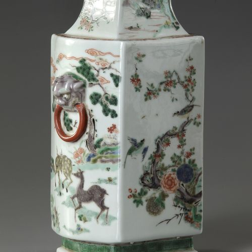 A Chinese famille verte vase Decorated with small butterflies in flight amongst …