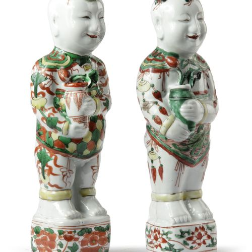A PAIR OF CHINESE FAMILLE VERTE FIGURES OF BOYS, KANGXI PERIOD (1662 1722) Each …