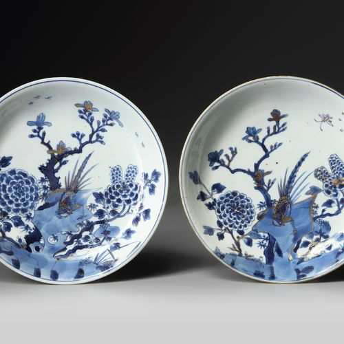 A PAIR OF CHINESE GILT DECORATED BLUE AND WHITE 'PHEASANT AND PEONY' DISHES, KAN…