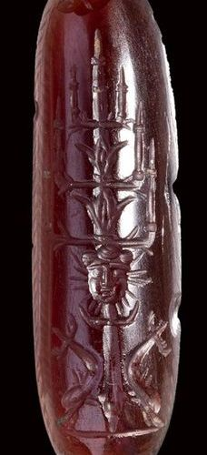 A post renaissance magical garnet amulet. Candelabrum with inscriptions.     17t…