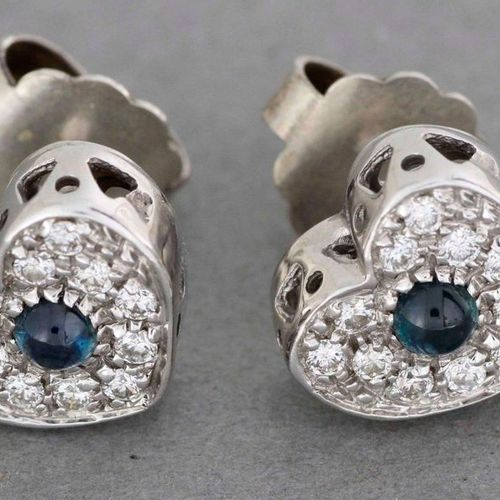 Pair of white gold heart shaped earrings enriched with a sapphire cabochon in a …