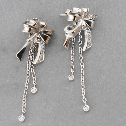 """Pair of """"Knot"""" earrings in white gold enriched with brilliants and pendants set …"""