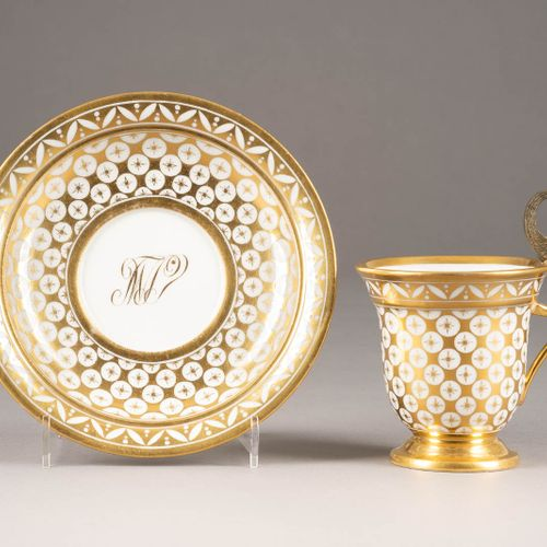 A PORCELAIN CUP WITH SPHINX HANDLE AND SAUCER Russian or French, circa 1820 Gold…