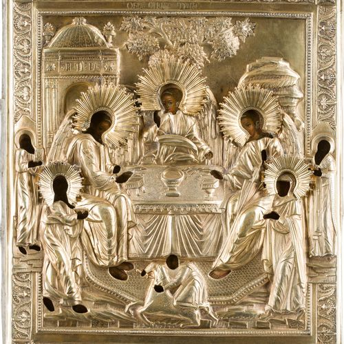 AN ICON SHOWING THE OLD TESTAMENT TRINITY WITH A SILVER GILT OKLAD Russian, circ…