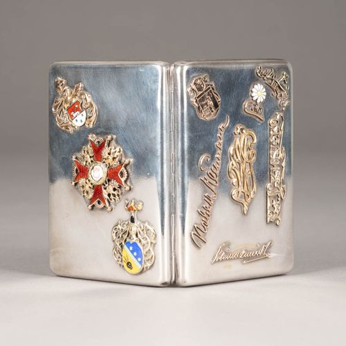 A SOLID SILVER CIGARETTE CASE SET WITH THE GOLD AND ENAMEL ORDER OF ST. STANISLA…