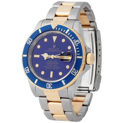 Rolex. Fine and Precious Submariner Automatic Wristwatch in Steel and Gold, Refe…