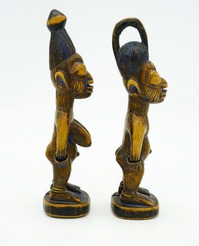 Pair of twins Ibedji Yoruba Nigeria Wood, brass, pigments H.: 23.5 cm. (each) Pa…