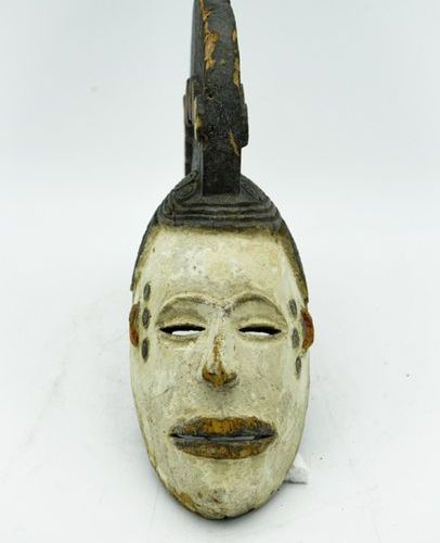 Mask agbogho mmwo Igbo Gabon Wood, pigments H.: 29 cm. This mask with idealized …