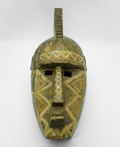 Bobo mask Burkina Faso Wood, pigments H.: 57 cm. Stylized mask with a face domin…