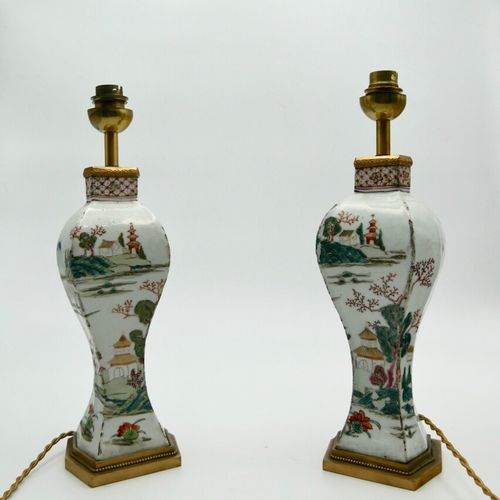 CHINA XIXth CENTURY  Pair of faceted baluster vases in polychrome enamelled porc…