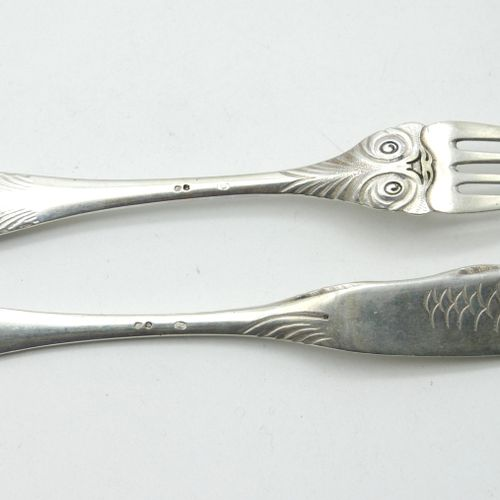 FOREIGN EMPLOYMENT  Twelve 800/1000e silver fish cutlery with engraved catfish h…