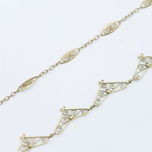 FRANCE 20th CENTURY  Gold necklace and chain 750/1000e with scrolls  Metal clasp…