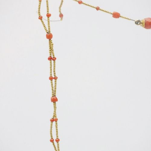 Early 20th century  Fine necklace made of two rows of golden pearls, decorated w…