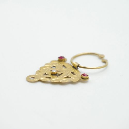 FRANCE 1838 1919  Part of a gold fibula set with two red stones and a pearl  Gro…