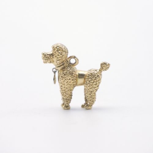 20th CENTURY  Gold pendant in the shape of a poodle  Weight : 9,29 g.  L. : 2,5 …