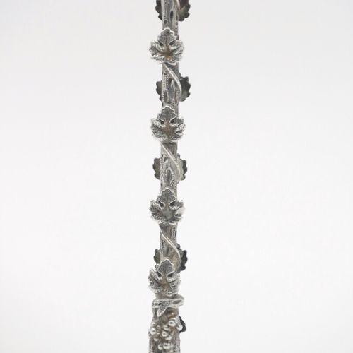 FRANCE XIXe SIÈCLE  Cuillère à tamponnoir en argent 950/1000e à décor finement c…