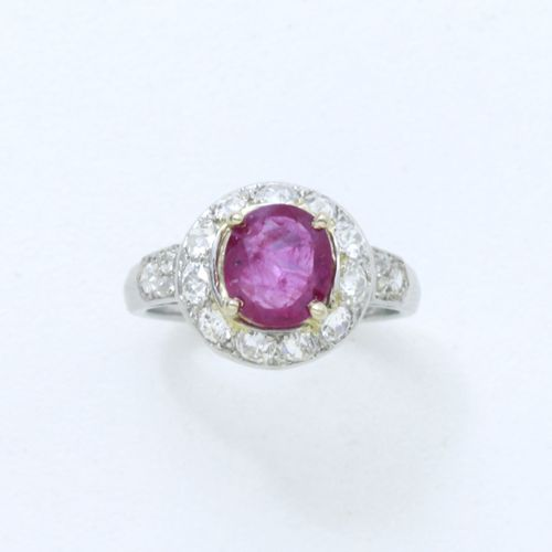 ART DECO CIRCA 1930  A platinum ring 850/1000e, set with an oval faceted ruby su…