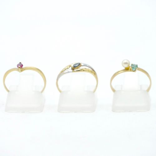 20th CENTURY  Lot of three gold rings 750/1000 : one set with a small pearl and …