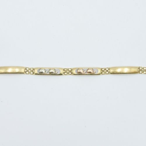 TRAVAIL ÉTRANGER XXe siècle  Bracelet articulé en or 750/1000e et argent à décor…