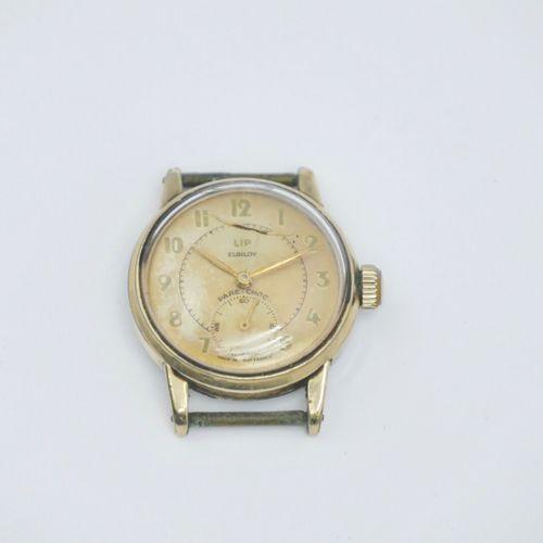 LIP Elgiloy Vers 1950  Boîtier en métal plaqué or, cadran à chiffres arabes, tro…