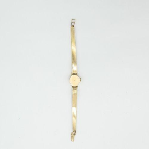 Montre bracelet de dame en or 750/1000e, cadran rond. Mouvement mécanique. Brace…