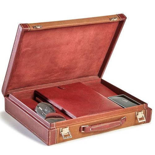 HERMÈS Paris made in France, circa 1970  Rare toiletry case in burgundy leather …
