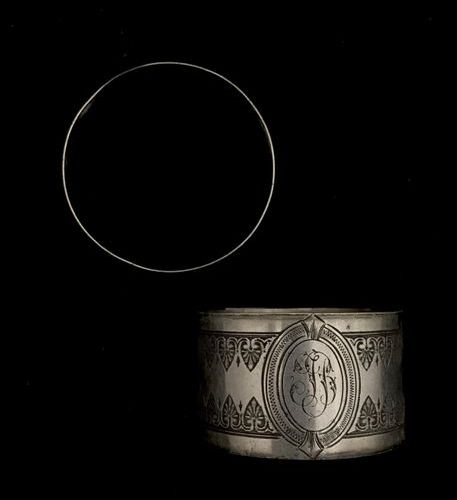 Two 950°/00 Minerva silver napkin rings, end of the XIXth century. Diameter : 5 …