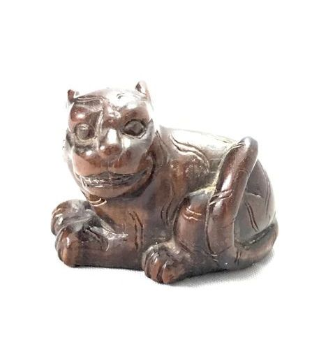 Wooden Netsuke, representing a tiger. Signed Nobuo. Japan, early 20th century. L…