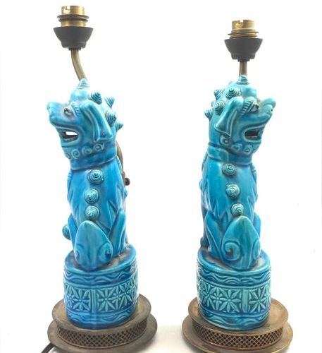 China A pair of turquoise blue ceramic Fô dogs, mounted as a lamp. Work from the…
