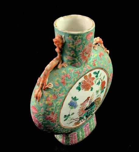 Lenticular shaped porcelain flask decorated with enamels of the rose family in t…
