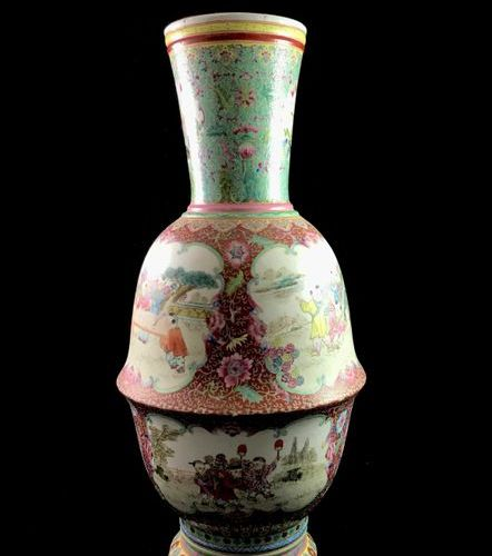 Large porcelain vase decorated with rose family enamels on a red background stre…