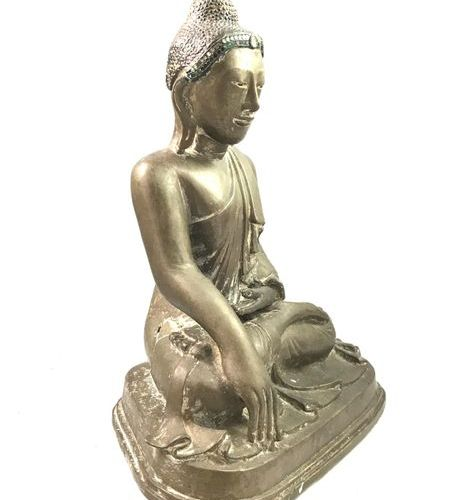 An important bronze Buddha with a brown patina, sitting in meditation, in bhumis…