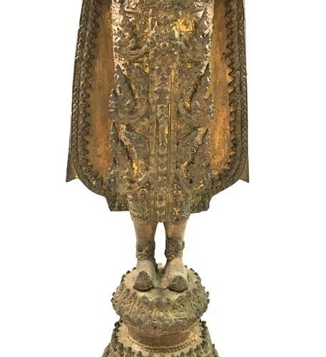 Partially gold lacquered bronze subject representing the Buddha, adorned and ric…