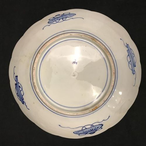 Large round porcelain dish with concentric decoration radiating cartouches in th…