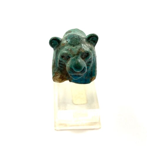 Fragment of a lion statuette Turquoise blue and black earthenware. Egypt, Middle…