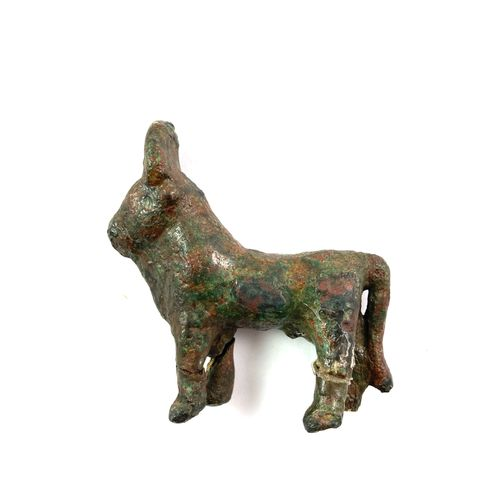 Apis Bull capped by the solar disc Bronze with a smooth dark green patina. Three…