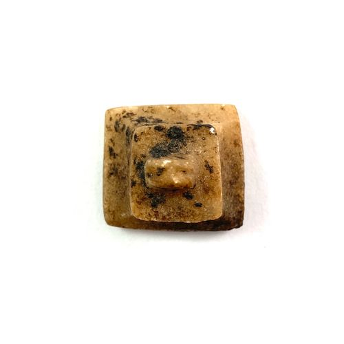 Batch comprising a cauri amulet, a rectangular pseudo seal amulet, a button beet…
