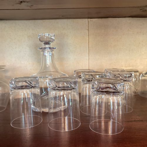 Contents of the third shelf: a blown crystal whisky set by Daum including a deca…