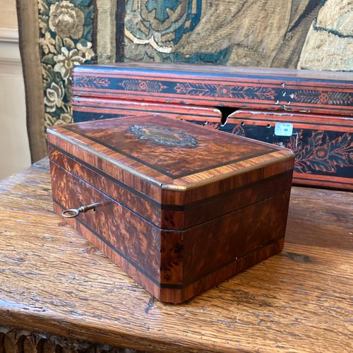 53 Rectangular chest with folded corners in burr walnut, ebony, brass and rosewo…
