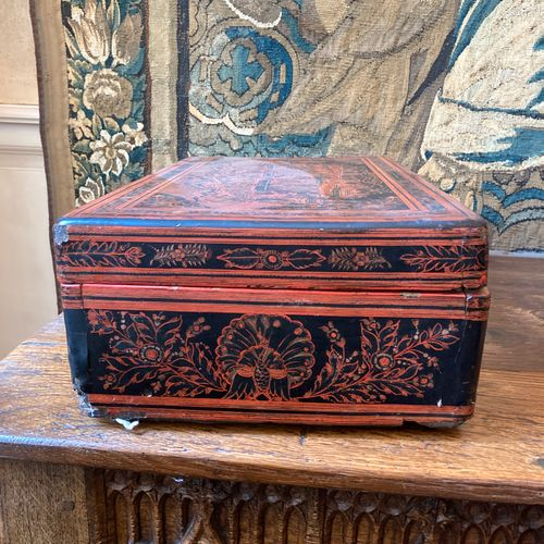 Large lacquered wooden box painted with a black background of aulic scenes. Chin…