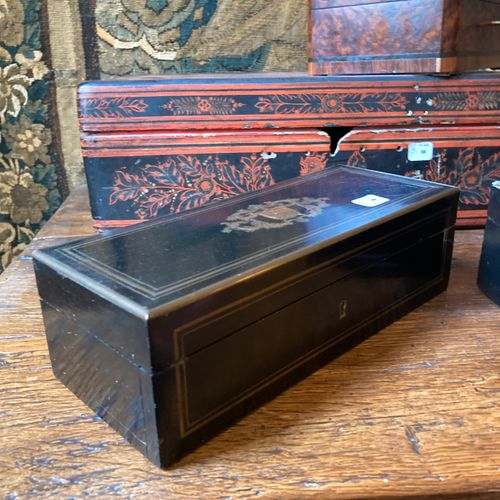Set of two rectangular glove boxes in stained wood and brass fillets. The lids a…