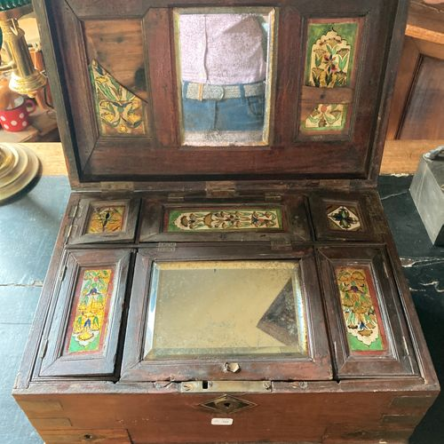 Cabinet made of stained and patinated wood. The interior has an ornamentation of…