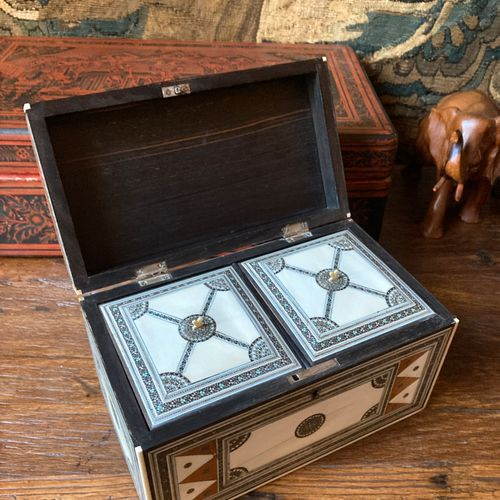 Tea chest with two compartments made of veneer and marquetry on an ivory backgro…