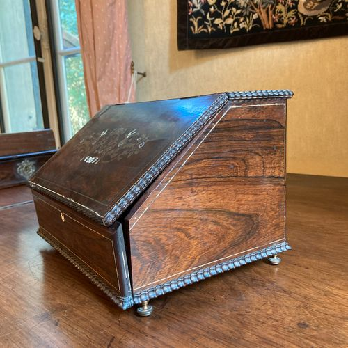 A rectangular rosewood mailbox, decorated with brass fillets and marquetry of mo…