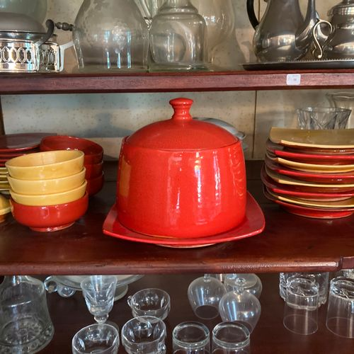 Contents of the second shelf: red and yellow earthenware service, terrine dish, …